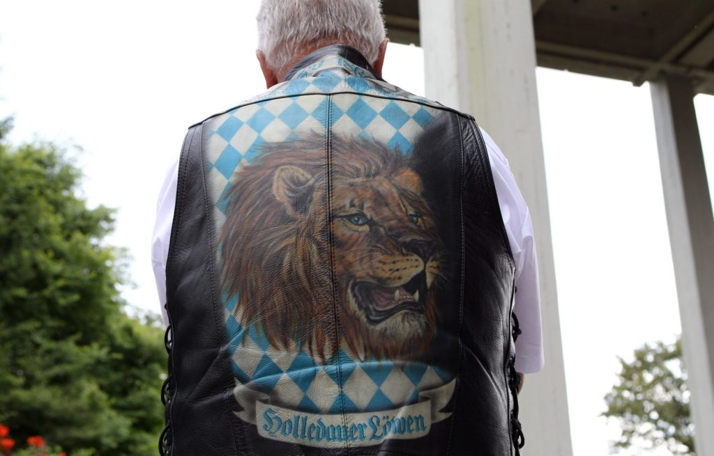 MUNICH, GERMANY - AUGUST 04: A fan of the football club TSV 1860 Muenchen attends the funeral service for the former president of the football club Karl-Heinz Wildmoser at the Waldfriedhof cemetery on August 4, 2010 in Munich, Germany.The former president of the football club TSV 1860 Muenchen died on July 28, 2010. (Photo by Miguel Villagran/Bongarts/Getty Images)