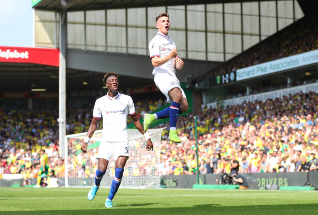 Mason Mount of Chelsea celebrates scoring his teams second goal with Tammy Abraham during the Premier League match between Norwich City and Chelsea FC