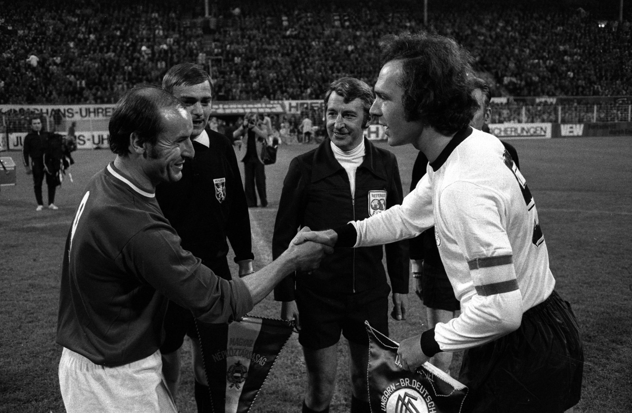 Ferenc Bene (Hungary ) and Franz Beckenbauer (West-Germany), with FIFA Referee Schaut (Belgium).