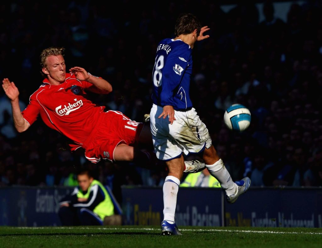 LIVERPOOL, UNITED KINGDOM - OCTOBER 20: Dirk Kuyt of Liverpool flying tackles Phil Neville of Everton during the Barclays Premier League match between Everton and Liverpool at Goodison Park on October 20, 2007 in Liverpool, England. (Photo by Clive Brunskill/Getty Images)