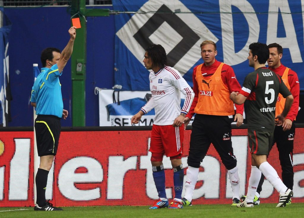 HAMBURG, GERMANY - MARCH 03: Paolo Guerrero of Hamburg gets the red card from referee Peter Sippel during the Bundesliga match between Hamburger SV and VfB Stuttgart at Imtech Arena on March 3, 2012 in Hamburg, Germany. (Photo by Joern Pollex/Bongarts/Getty Images)