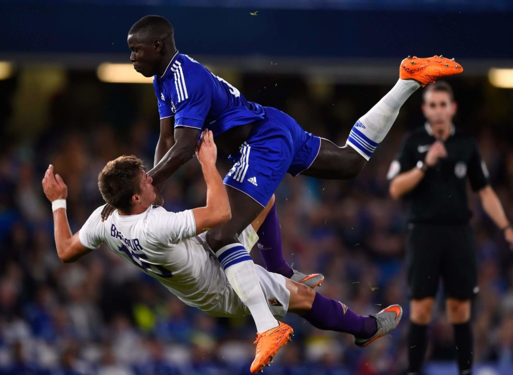 LONDON, ENGLAND - AUGUST 05: (Editor's note: re-crop of image 483033144) Kurt Zouma of Chelsea smashes into Ricardo Bagadur of Fiorentina during a Pre Season Friendly between Chelsea and Fiorentina at Stamford Bridge on August 5, 2015 in London, England. (Photo by Mike Hewitt/Getty Images)