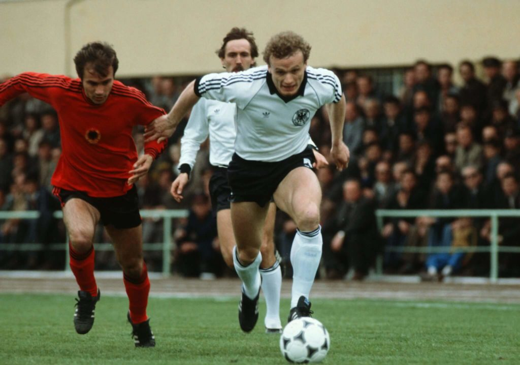 TIRANA, ALBANIA - MARCH 30: Hans Peter Briegel of Germany in action during the European Championship Qualifying match between Albania and Germany on March 30, 1983 in Tirana, Albania. (Photo by Bongarts/Getty Images)