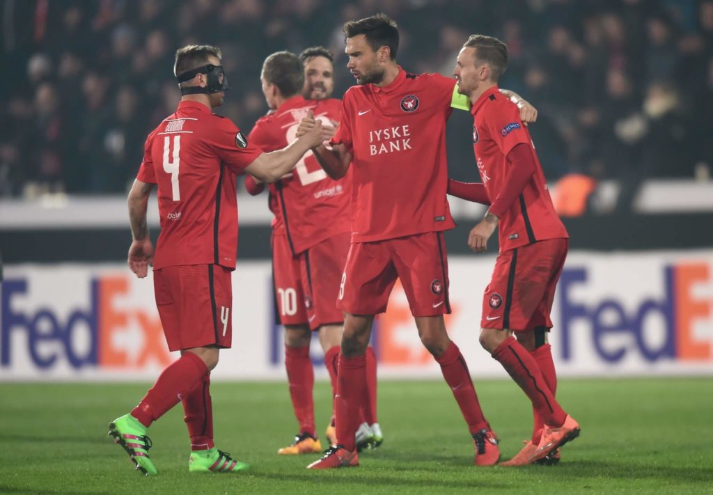 HERNING, DENMARK - FEBRUARY 18: FC Midtjylland players celebrate their 2-1 win in the UEFA Europa League round of 32 first leg match between FC Midtjylland and Manchester United at Herning MCH Multi Arena on February 18, 2016 in Herning, Denmark. (Photo by Michael Regan/Getty Images)