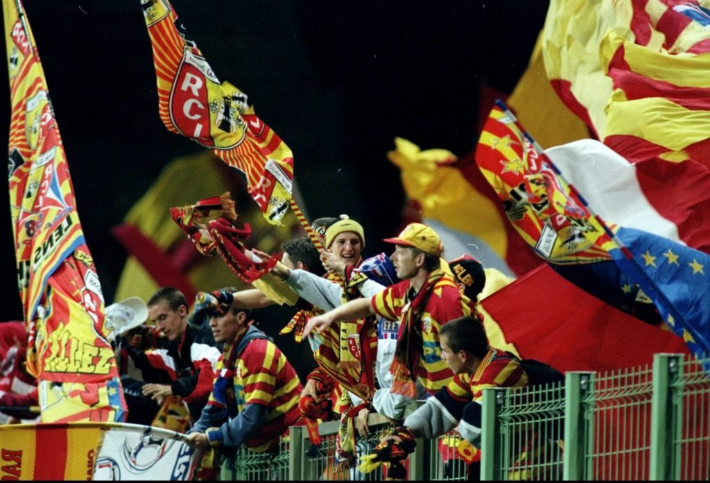 16 Sep 1998: Lens fans at the UEFA Champions League match against Arsenal at the Stade Felix Bollaert in Lens, France. The game ended 1-1. Mandatory Credit: Ben Radford /Allsport