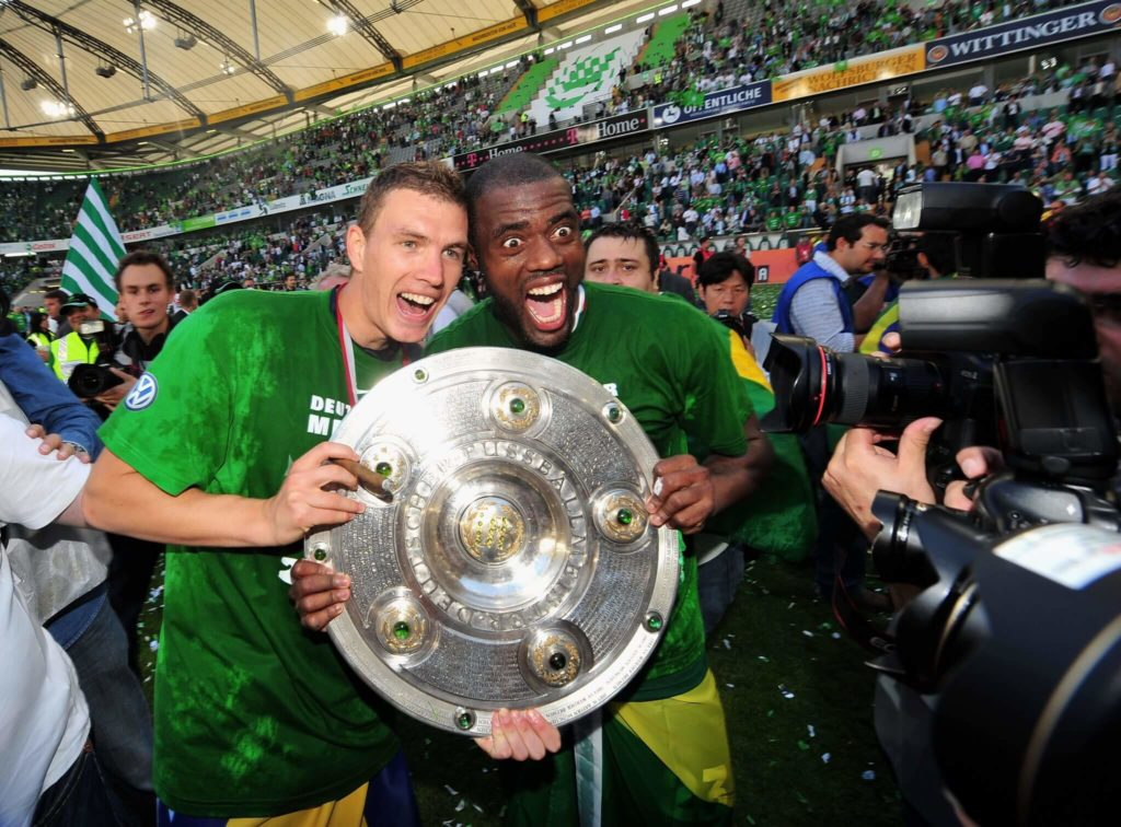 WOLFSBURG, GERMANY - MAY 23: Edin Dzeko and Grafite of Wolfsburg celebrate the German championship with the trophy after their Bundesliga match against SV Werder Bremen on May 23, 2009 in Wolfsburg, Germany. Wolfsburg won its first German championship ever at Volkswagen Arena on May 23, 2009 in Wolfsburg, Germany. (Photo by Stuart Franklin/Bongarts/Getty Images)