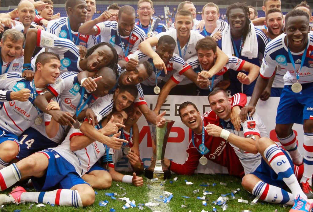 HARRISON, NJ - JULY 28: Olympique Lyonnais celebrates after defeating Montpellier HSC to win the Tours de Champions at Red Bull Arena on July 28, 2012 in Harrison, New Jersey. (Photo by Mike Stobe/Getty Images for New York Red Bulls)