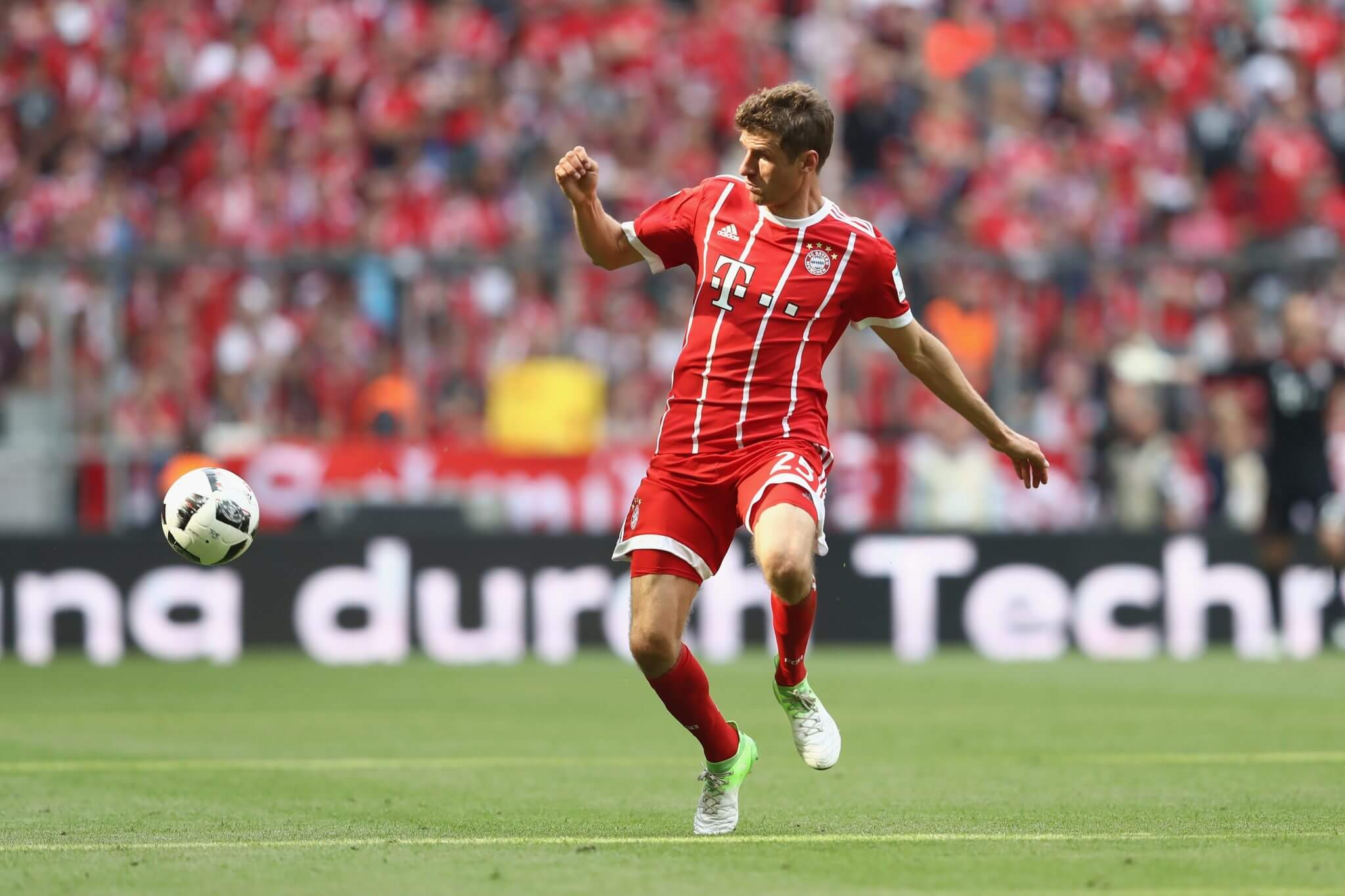 MUNICH, GERMANY - MAY 20: Thomas Mueller of Bayern Muenchen runs with the ball during the Bundesliga match between Bayern Muenchen and SC Freiburg at Allianz Arena on May 20, 2017 in Munich, Germany. (Photo by Alexander Hassenstein/Bongarts/Getty Images)