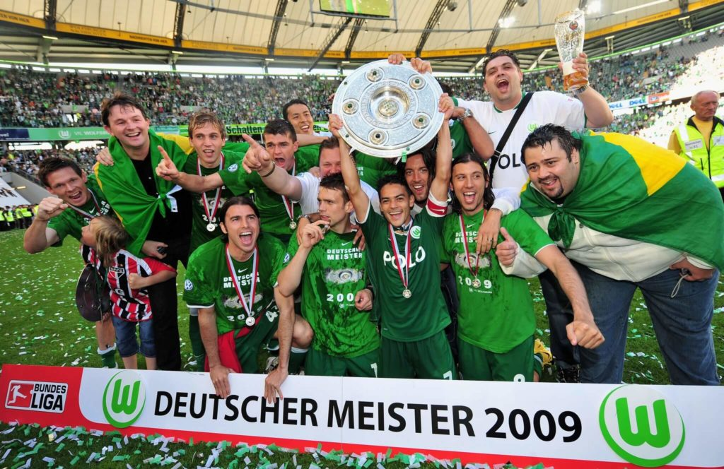 WOLFSBURG, GERMANY - MAY 23: Players of Wolfsburg celebrate the German championship with the trophy after their Bundesliga match against SV Werder Bremen on May 23, 2009 in Wolfsburg, Germany. Wolfsburg won its first German championship ever at Volkswagen Arena on May 23, 2009 in Wolfsburg, Germany. (Photo by Stuart Franklin/Bongarts/Getty Images)
