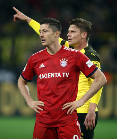 DORTMUND, GERMANY - NOVEMBER 10: Robert Lewandowski of Muenchen and Lukas Piszczek of Dortmund react during the Bundesliga match between Borussia Dortmund and FC Bayern Muenchen at Signal Iduna Park on November 10, 2018 in Dortmund, Germany.