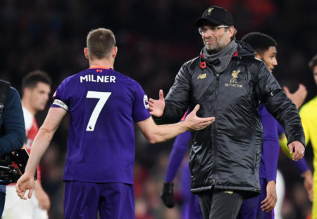 LONDON, ENGLAND - NOVEMBER 03: James Milner of Liverpool is embraced by Jurgen Klopp, Manager of Liverpool after the Premier League match between Arsenal FC and Liverpool FC at Emirates Stadium on November 3, 2018 in London, United Kingdom.