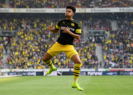 STUTTGART, GERMANY - OCTOBER 20: Jadon Sancho of Borussia Dortmund celebrates after scoring his team's first goal during the Bundesliga match between VfB Stuttgart and Borussia Dortmund at Mercedes-Benz Arena on October 20, 2018 in Stuttgart, Germany.