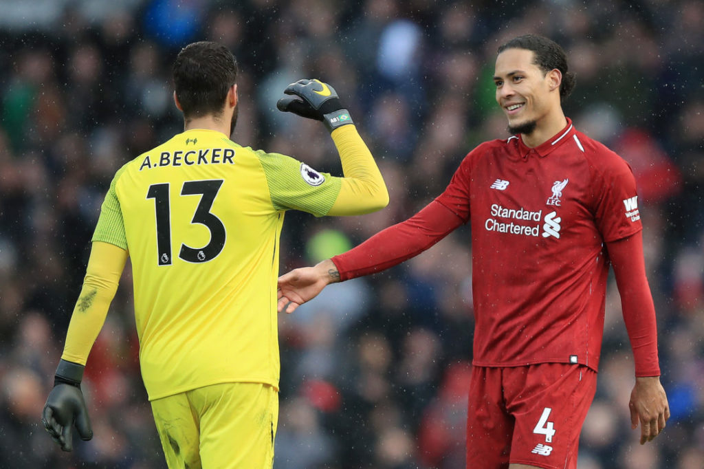 LONDON, ENGLAND - MARCH 17: Alisson of Liverpool shakes hands with Virgil van Dijk of Liverpool after the Premier League match between Fulham FC and Liverpool FC at Craven Cottage on March 17, 2019 in London, United Kingdom.