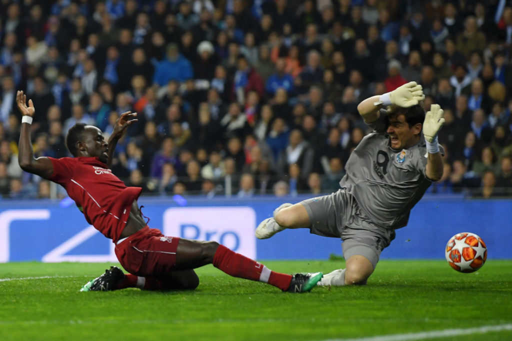 PORTO, PORTUGAL - APRIL 17: Sadio Mane of Liverpool scores his team's first goal under pressure from Iker Casillas of FC Porto during the UEFA Champions League Quarter Final second leg match between Porto and Liverpool at Estadio do Dragao on April 17, 2019 in Porto, Portugal.