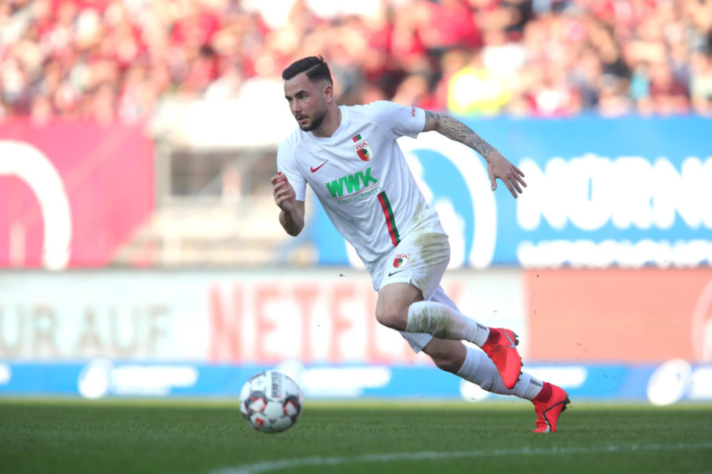 NUREMBERG, GERMANY - MARCH 30: Marco Richter of Augsburg runs with the ball during the Bundesliga match between 1. FC Nuernberg and FC Augsburg at Max-Morlock-Stadion on March 30, 2019 in Nuremberg, Germany.