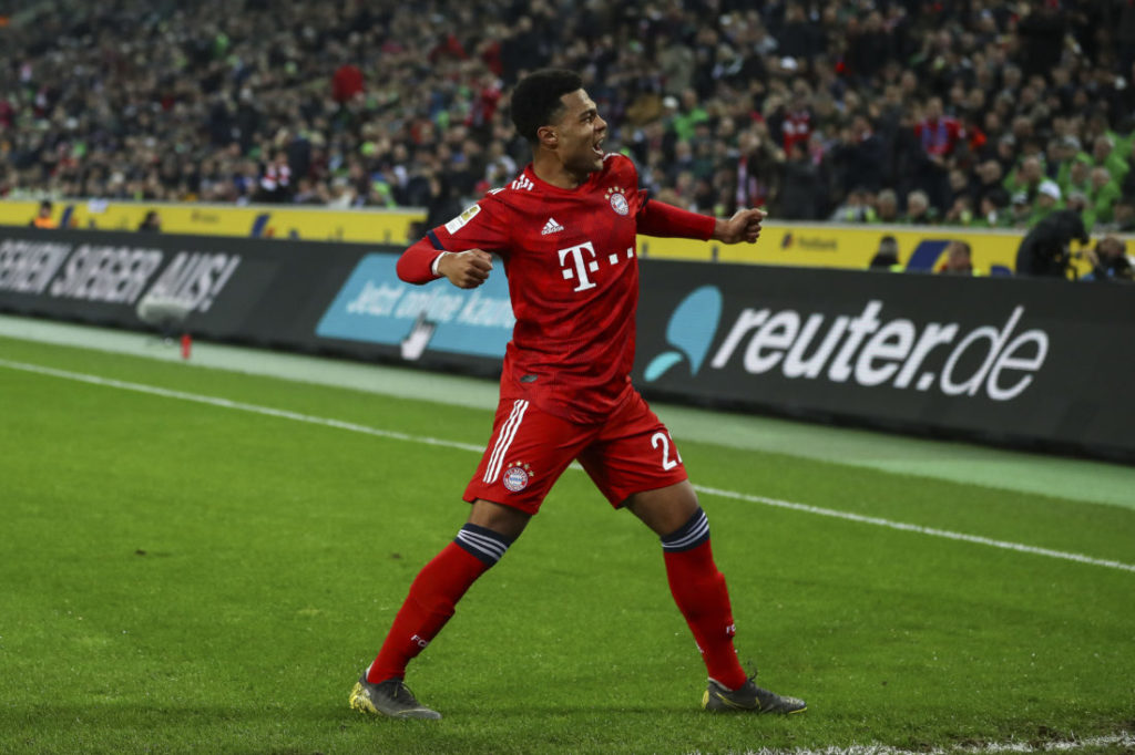 MOENCHENGLADBACH, GERMANY - MARCH 02: Serge Gnabry #22 of Bayern Munich celebrates scoring his sides fourth goal during the Bundesliga match between Borussia Moenchengladbach and FC Bayern Muenchen at Borussia-Park on March 02, 2019 in Moenchengladbach, Germany.