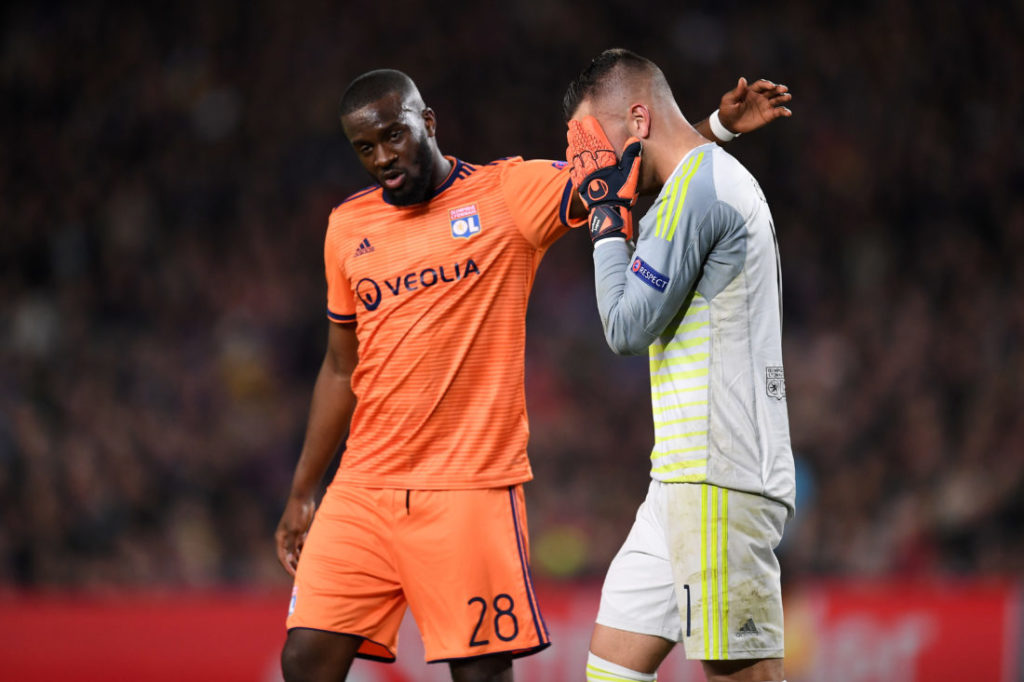 BARCELONA, SPAIN - MARCH 13: An injured Anthony Lopes of Olympique Lyonnais reacts as he leaves the pitch alongside Tanguy Ndombele during the UEFA Champions League Round of 16 Second Leg match between FC Barcelona and Olympique Lyonnais at Nou Camp on March 13, 2019 in Barcelona, Spain.