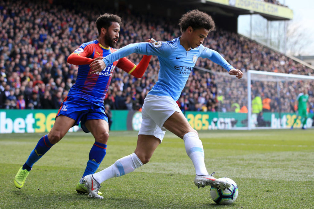 LONDON, ENGLAND - APRIL 14: Leroy Sane of Manchester City evades Andros Townsend of Crystal Palace during the Premier League match between Crystal Palace and Manchester City at Selhurst Park on April 14, 2019 in London, United Kingdom.