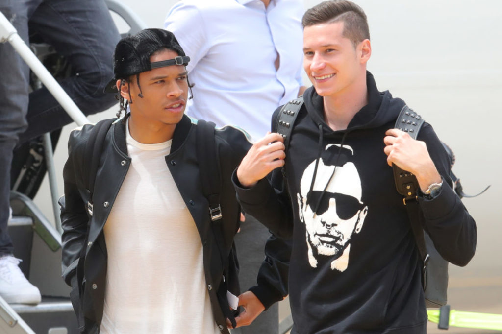 BOLZANO, ITALY - MAY 23:  Julian Draxler and  Leroy Sane (L) arrives with the German National team at Bolzano Airport for the Southern Tyrol Training Camp ahead of the FIFA World Cup Russia 2018 on May 23, 2018 in Bolzano, Italy.