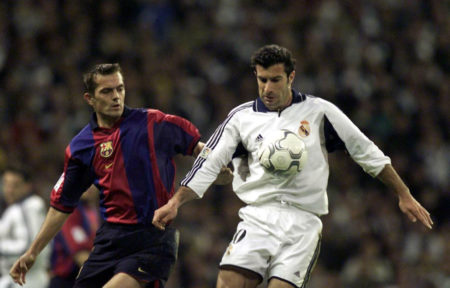 3 Mar 2001: Lusi Figo of Real Madrid holds off Philip Cocu of Barcelona during the Real Madrid v FC Barcelona La Liga match played at the Santiago Bernabeau, Madrid.