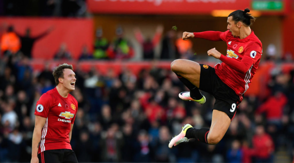 SWANSEA, WALES - NOVEMBER 06: : Zlatan Ibrahimovic of Manchester United celebrates scoring his sides second goal with Phil Jones (l) during the Premier League match between Swansea City and Manchester United at Liberty Stadium on November 6, 2016 in Swansea, Wales.