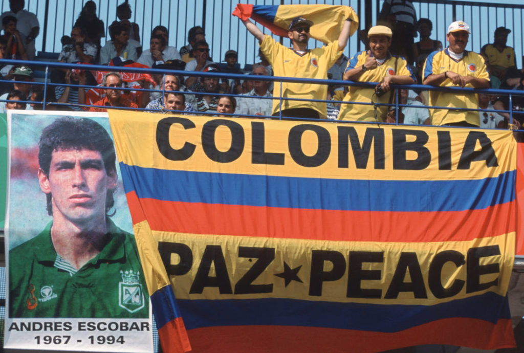 MONTPELLIER, FRANCE - JUNE 22: Fans of Colombia display a banner from Andres Escobar, who was murdered after the World Cup 1994, during the FIFA World Cup group d match between Colombia and Tunesia on June 22, 1998 in Montpellier, France.