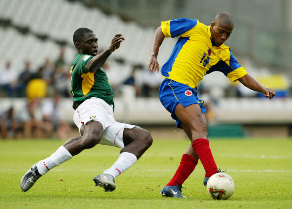 LYON - JUNE 26: Marc-Vivien Foe of Cameroon attempt a tackle on Jorge Lopez of Colombia during the Confederations Cup Semi-Final match between Colombia and Cameroon on June 26, 2003 at the Stade Gerland in Lyon, France. Cameroon won the match 1-0.