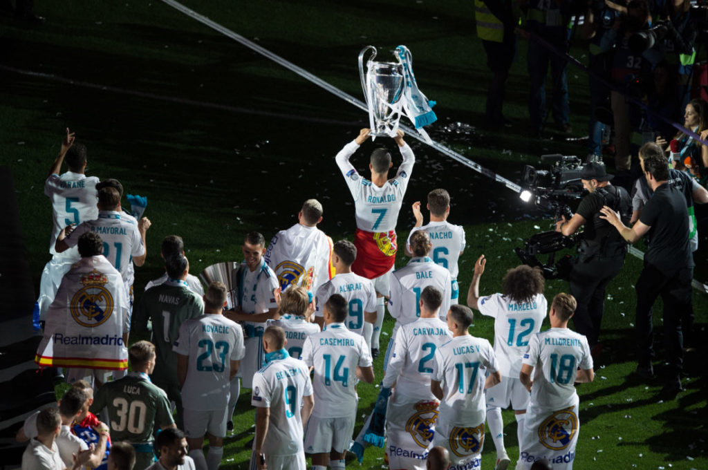 MADRID, SPAIN - MAY 27: Cristiano Ronaldo of Real Madrid celebrates with teammates during celebrations at the Santiago Bernabeu stadium following their victory last night in Kiev in the UEFA Champions League final, on May 27, 2018 in Madrid, Spain. Real beat Liverpool 3-1 in the final to lift the European Cup and Champions League for the 13th time.