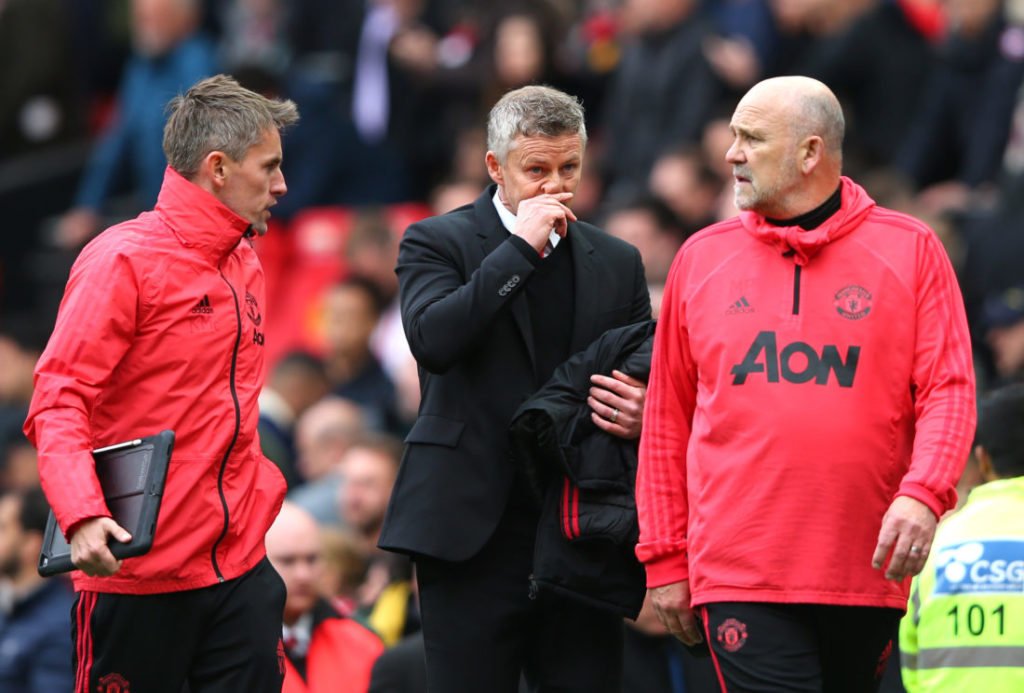 MANCHESTER, ENGLAND - APRIL 28: Ole Gunnar Solskjaer, Manager of Manchester United and coaches Mike Phelan and Kieran McKenna in discussion at half time during the Premier League match between Manchester United and Chelsea FC at Old Trafford on April 28, 2019 in Manchester, United Kingdom.