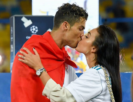 KIEV, UKRAINE - MAY 26:  Cristiano Ronaldo of Real Madrid CF kisses hsi girlfriend Georgina Rodriguez as they celebrate his side victory following winning the UEFA Champions League final between Real Madrid and Liverpool on May 26, 2018 in Kiev, Ukraine.