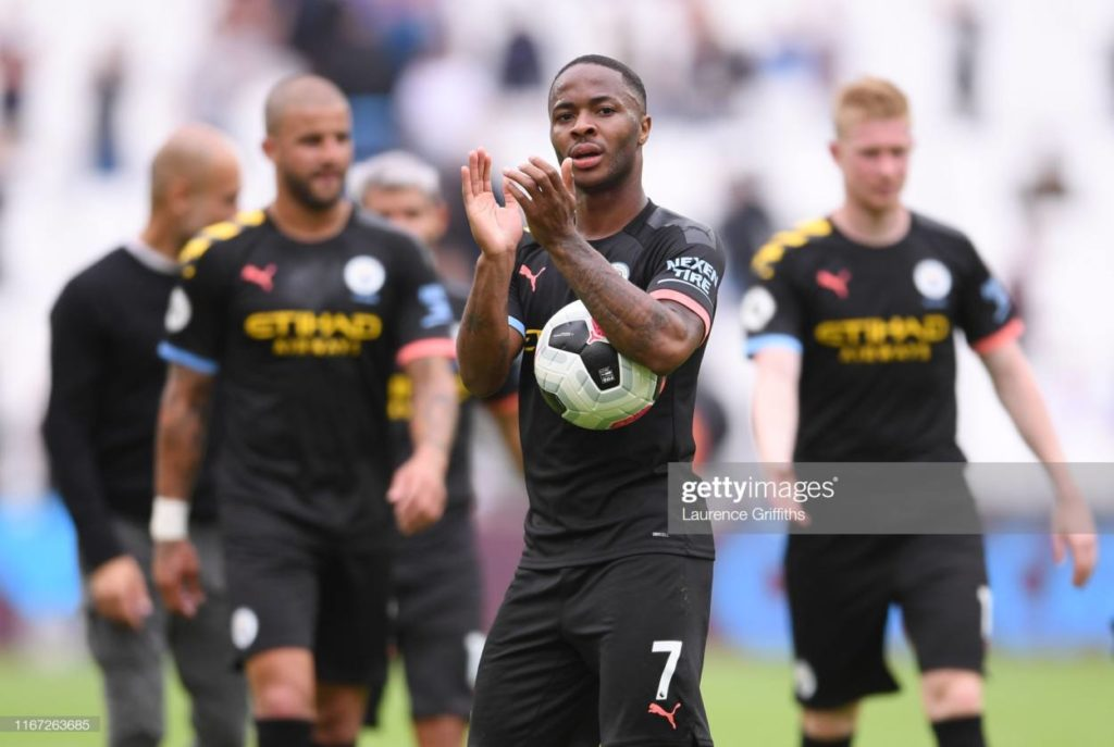 Raheem Sterling of Manchester City applauds the fans after scoring a hat trick
