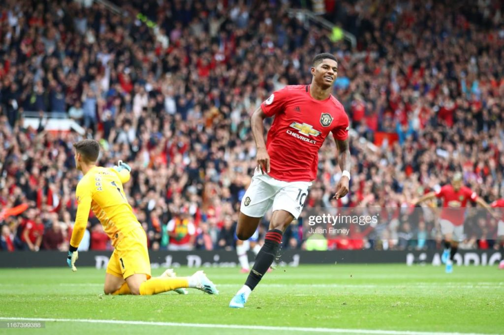 Marcus Rashford of Manchester United celebrates after scoring his team's third goal during the Premier League match