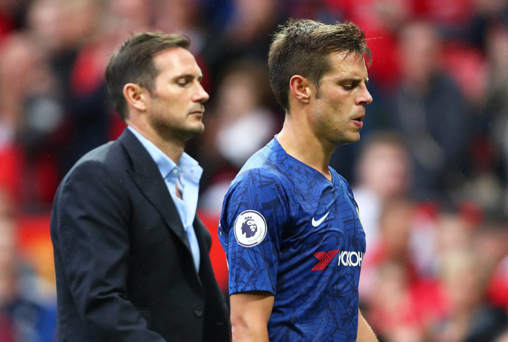 MANCHESTER, ENGLAND - AUGUST 11: Frank Lampard manager of Chelsea and captain Cesar Azpilicueta of Chelsea walk off the pitch during the Premier League match between Manchester United and Chelsea FC at Old Trafford on August 11, 2019 in Manchester, United Kingdom.