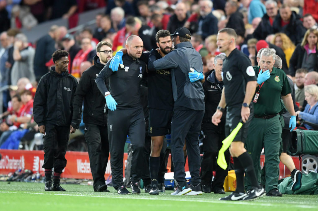 LIVERPOOL, ENGLAND - AUGUST 09: Alisson Becker of Liverpool leaves the pitch following an injury during the Premier League match between Liverpool FC and Norwich City at Anfield on August 09, 2019 in Liverpool, United Kingdom. (Photo by Michael Regan/Getty Images)