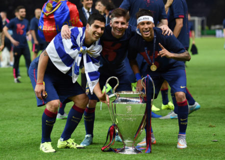 Luis Suarez, Lionel Messi and Neymar of Barcelona celebrate with the trophy after the UEFA Champions League Final between Juventus and FC Barcelona