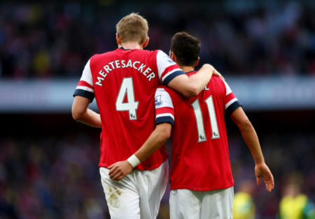 Per Mertesacker and Mesut Ozil