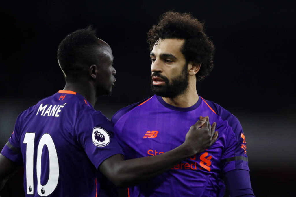 LONDON, ENGLAND - NOVEMBER 03: Sadio Mane of Liverpool and Mohamed Salah of Liverpool look on during the Premier League match between Arsenal FC and Liverpool FC at Emirates Stadium on November 3, 2018 in London, United Kingdom.