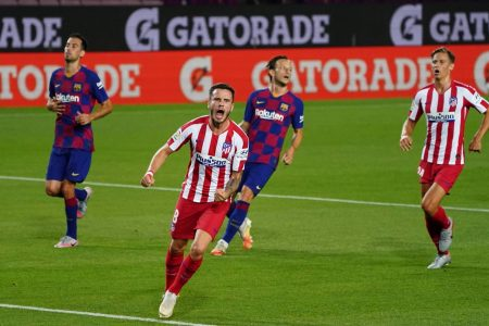 Lionel Messi scored his 700th career goal but FC Barcelona dropped points again with a 2-2 draw against Atletico Madrid as Saul Niguez scored twice.