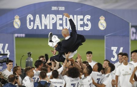 Karim Benzema scored twice as Real Madrid beat high-flying Villarreal by 2-1 and win their 34th La Liga title and Zidane's 11th trophy with the Whites.